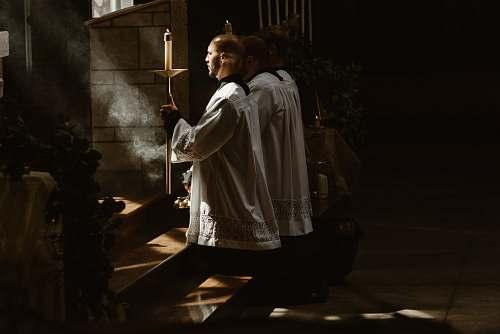 person two man worshiping god during daytime human