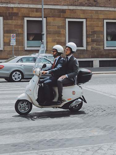person two men riding on motor scooter human