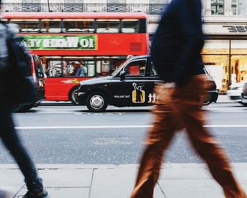 bus two person walking on sidewalks vehicle