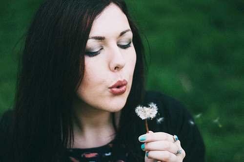 human woman blowing white dandelion person
