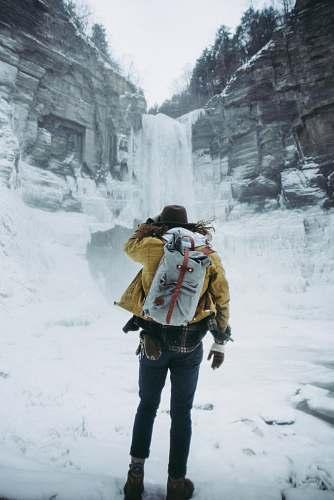 human woman facing frozen waterfalls person
