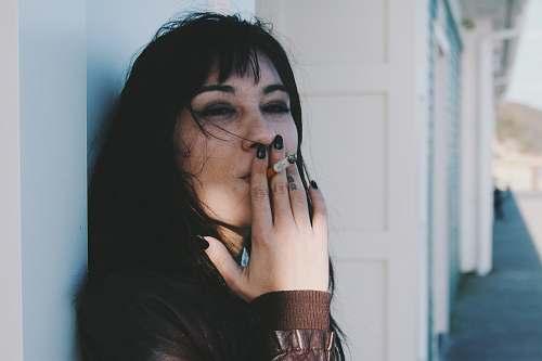 human woman holding cigarette stick person
