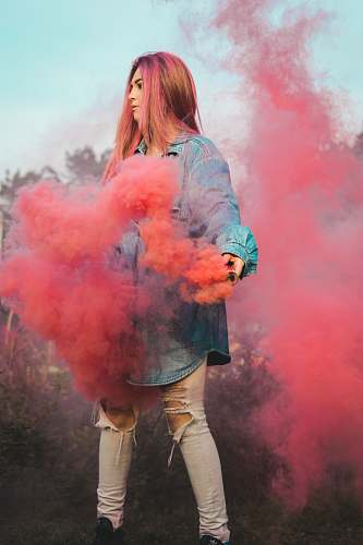 person woman holding red smoke human