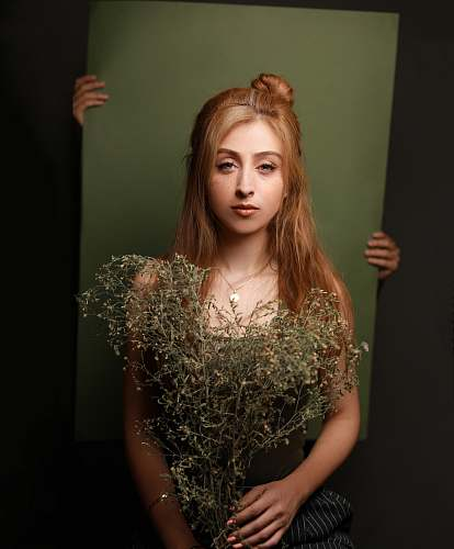 person woman holding withered plants plant