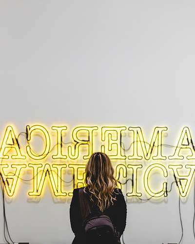person woman in front American lighted signage human