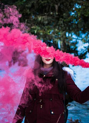 person woman in red parka using smoke screen human
