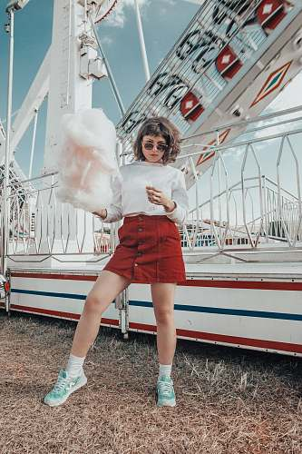person woman in white long-sleeved top holding cotton candy human