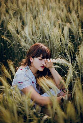 person woman sitting on grass human