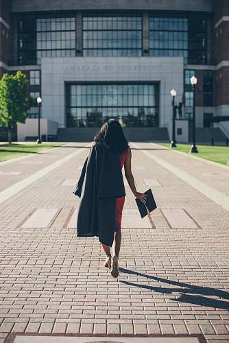 person woman standing at facade of Alabama University building human