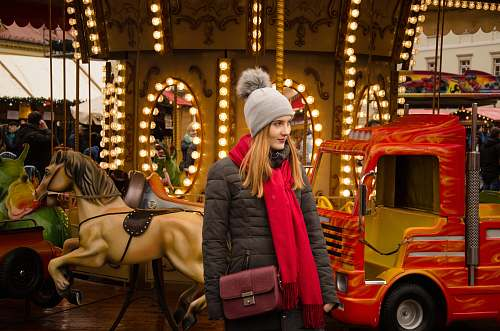 person woman standing near lighted carousel human