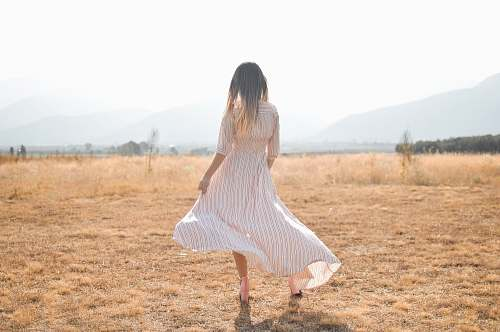person woman standing on plain brown field human
