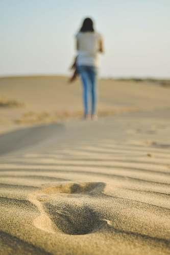 person woman walking on sad human