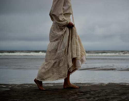 person woman walking on seashore human