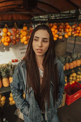 person woman wearing blue jacket in fruit store human