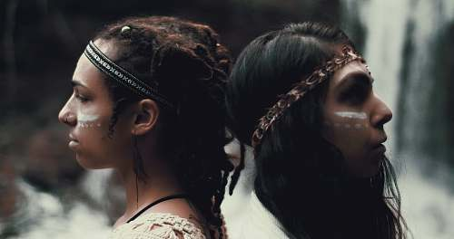 people closeup photo of two women wearing headbands human