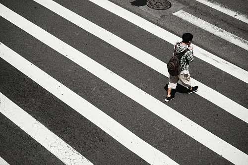 people man crossing at pedestrian lane zebra crossing