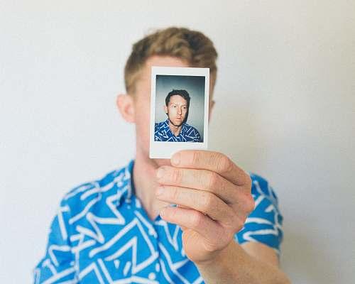 people man showing photo of him human