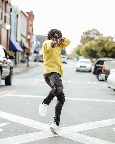 people man standing on street at daytime human