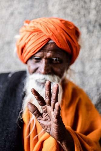 people man wearing orange turban turban