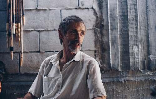 people man wearing white button-up shirt human