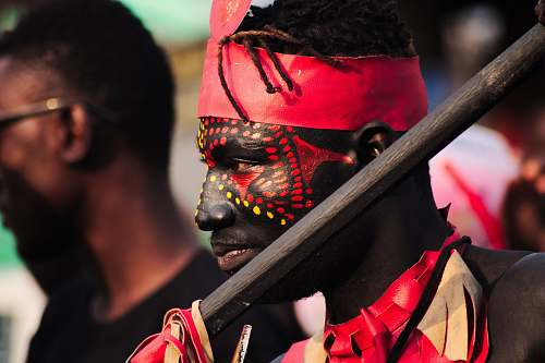 people man with red and yellow face paint human