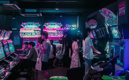 people people playing arcade games human