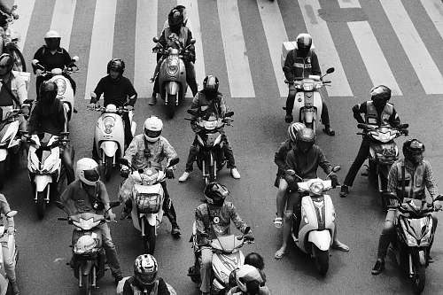 people people ride-on motorcycles at the road grayscale photography black-and-white