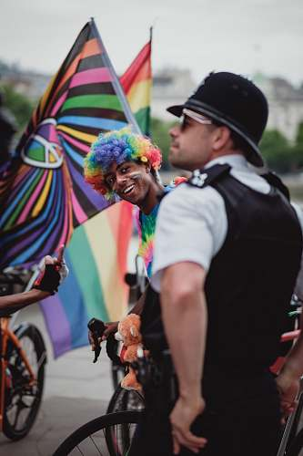 people person wearing rainbow wig riding bicycle human
