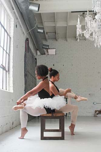 people photo of two ballerina tying their shoes human