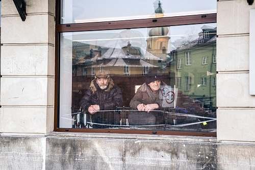 people two men standing beside window human