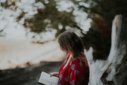 people woman holding book on beach human