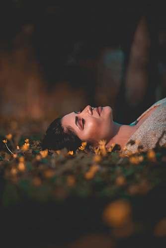 people woman lying on grass human