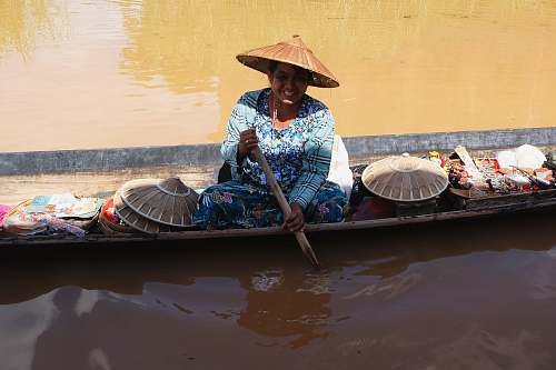 people woman rowing boat on body of water boat