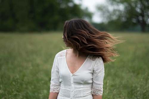 human woman standing in grass field people