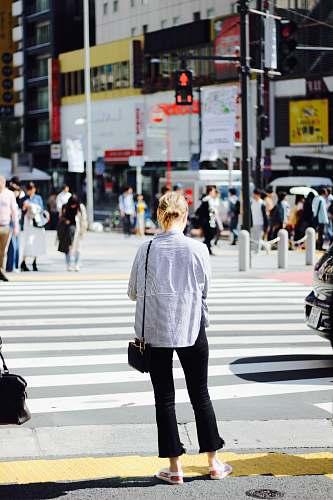 people woman standing in pedestrian lane human
