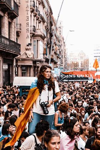 people woman standing on crowd of people human