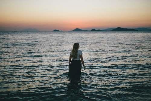 people woman walking on body of water human