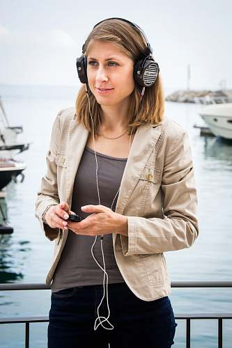 clothing woman using headphones] person