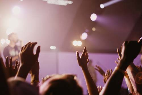 worship group of people listening to concert hands