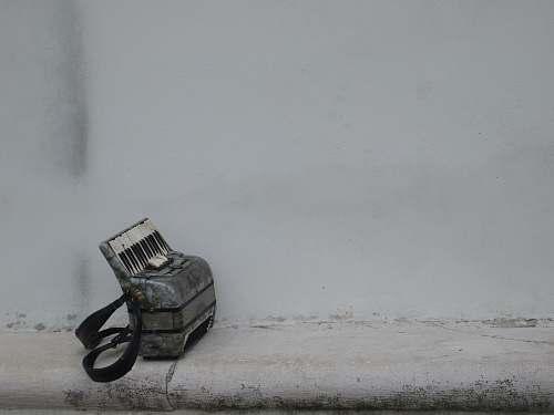grey gray harmonium on white surface machine