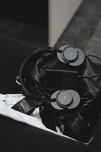 grey grayscale photo of headset and music player electronics