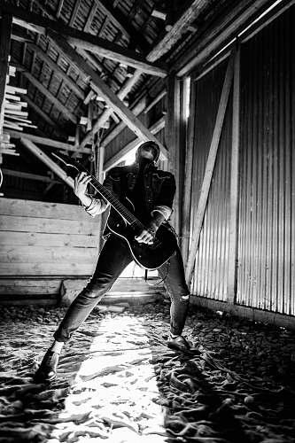guitar man playing electric guitar beside wall music