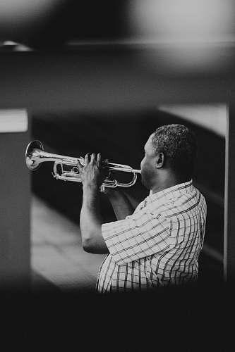music man playing trumpet trumpet