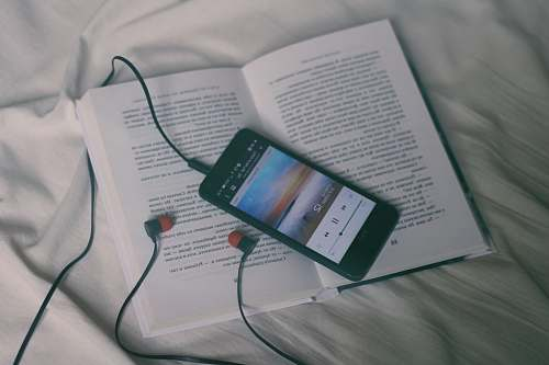 reading black smartphone on white book page calm