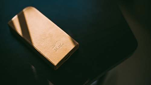 music gold leather wallet on tabletop speaker