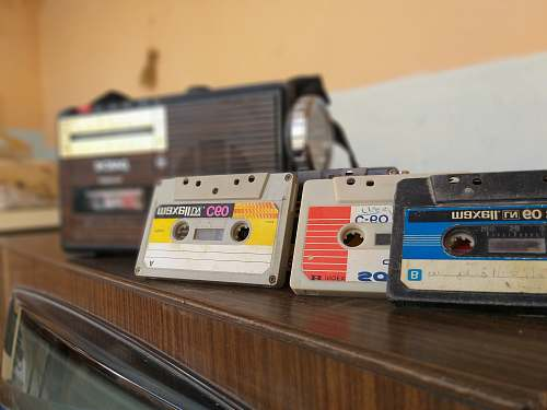 vintage cassette tapes on brown wooden surface radio