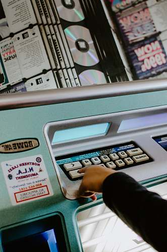 player person touching white button on machine album