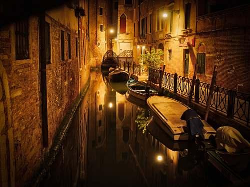 venice boats between buildings italy