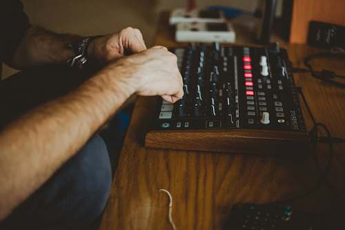 computer keyboard person playing audio interface inside well-lit room electronics