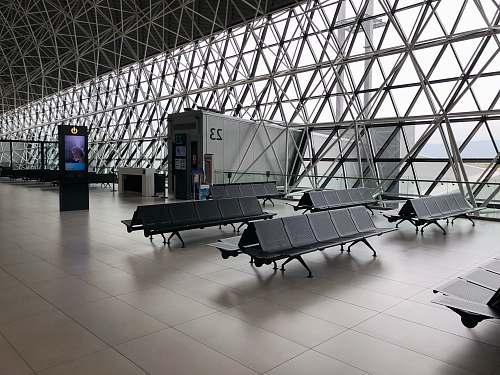 space black metal gang chairs on white ceramic flooring seatting